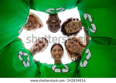 Low angle view of people wearing green shirt with recycling symbol on it on white background - stock photo