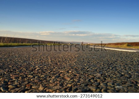 Low angle view of road with shallow depth of field and copy-space. - stock photo