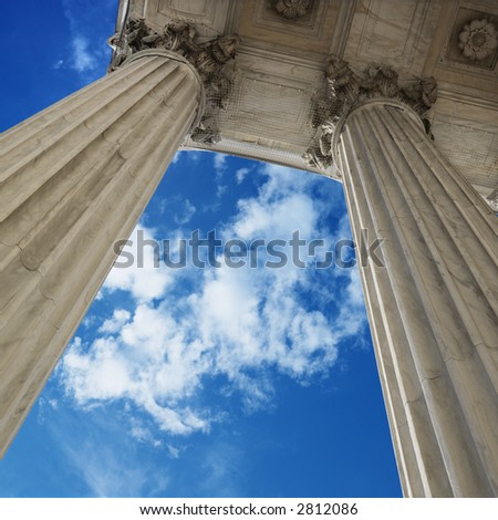 Low angle view of sky and columns of Supreme Court building in Washington D.C. - stock photo
