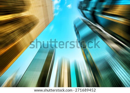 low angle view of skyscrapers in blurred motion. - stock photo