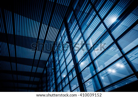 low angle view of steel glass airport ceiling ,chongqing china,blue toned image. - stock photo