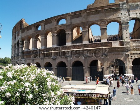 Low Angle view of the Colosseum Amphitheater in Rome against blue sky background. - stock photo