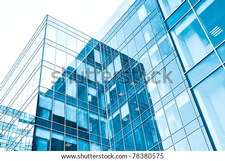 low angle view to light glass buildings of business center - stock photo