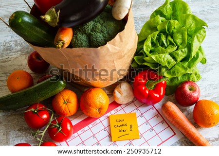 Low calorie diet,  vegetables and fruits  - stock photo