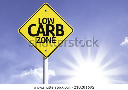 Low Carb Zone road sign with sun background  - stock photo