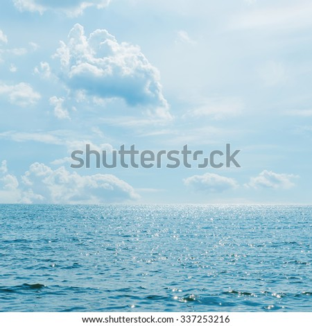 low clouds over sea with wave - stock photo