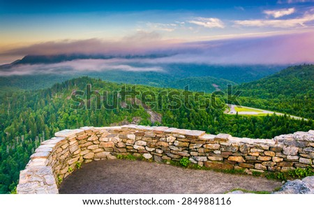 Low clouds over the Appalachian Mountains at sunrise, seen from Devil's Courthouse, near the Blue Ridge Parkway in North Carolina. - stock photo