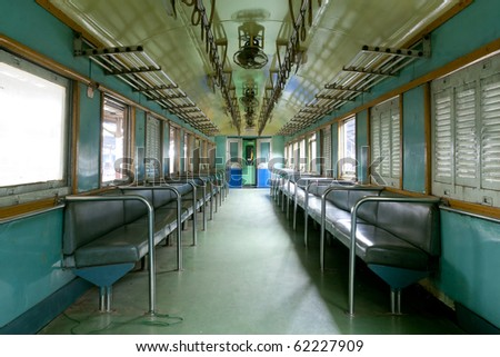 Low cost train passenger seat wagon - stock photo