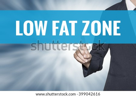 Low Fat Zone word on virtual screen touch by business woman cyan sky tab - stock photo