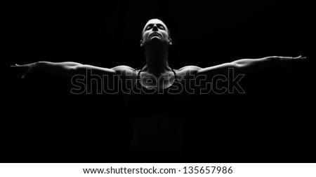 Low key fitness woman on black background. - stock photo