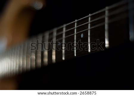low-key Guitar with shallow dof - stock photo