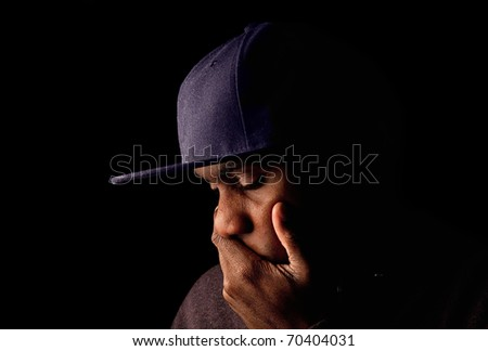 Low key image of a man expressing emotion - stock photo