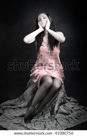 Low key lighting studio shot young beautiful women in pink lingerie. Great image for calendar. - stock photo