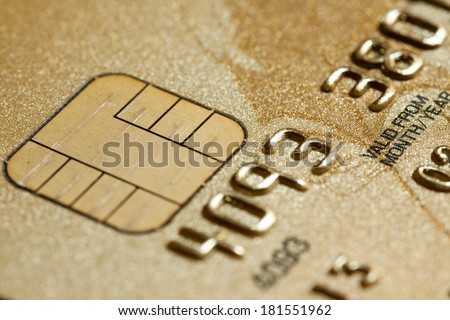 Low key macro shot with credit card - stock photo