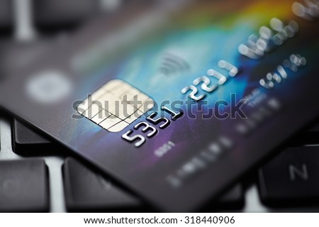 Low key macro shot with credit card. - stock photo