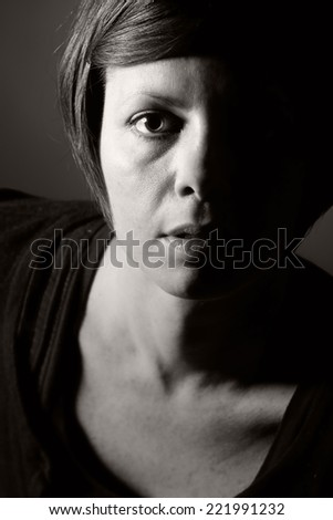 Low Key Photo of 30s Woman - stock photo