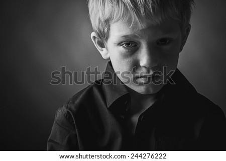 Low Key Photo of Sad Boy - stock photo