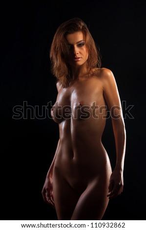 low key photo of sexy woman body on black - stock photo
