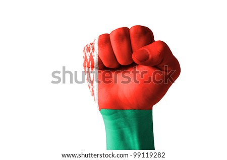 Low key picture of a fist painted in colors of belarus flag