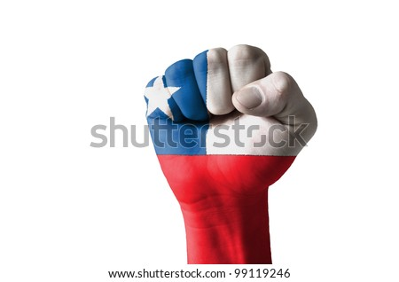 Low key picture of a fist painted in colors of chile flag