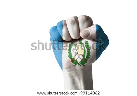 Low key picture of a fist painted in colors of guatemala flag - stock photo