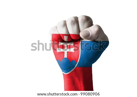 Low key picture of a fist painted in colors of slovakia flag - stock photo