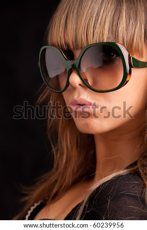Low Key Portrait - Woman in sunglasses - stock photo