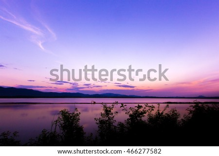 Low key-River and mountain silhouettes in sunset, north of Thailand, with color effect.