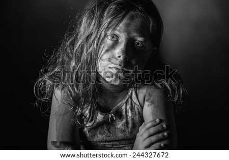 Low Key Shot of a Filthy Child - stock photo