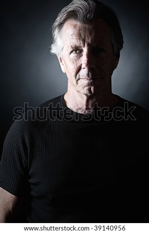 Low Key Shot of a Handsome Senior Male - stock photo