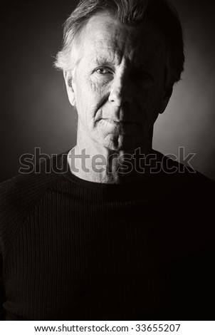 Low Key Shot of a Handsome Senior Man - stock photo