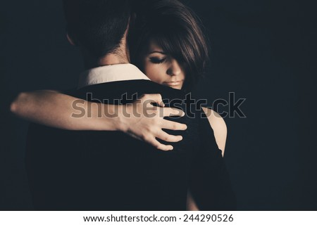 Low Key Shot of a Young Couple Embracing - stock photo