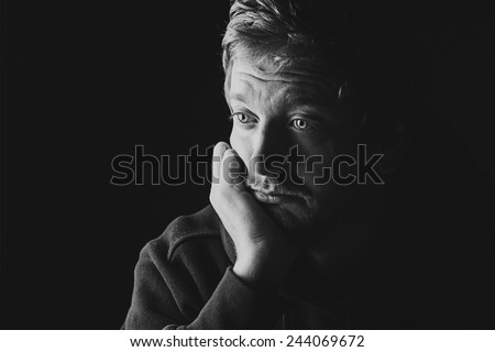 Low Key Shot of  Sad Male - stock photo