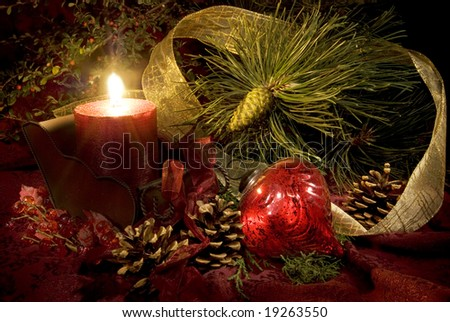 Low key still life of Christmas decorations in reds and greens. - stock photo