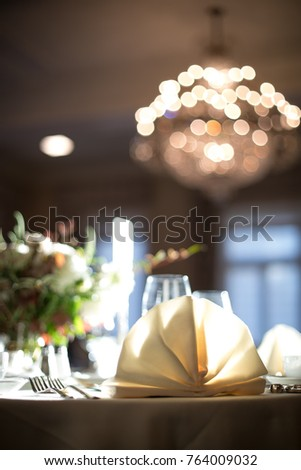 Low Perspective Close Up On A Formal Wedding Table Place Setting With Folded Dinner Napkin