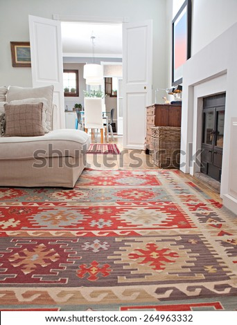Low perspective still life of interior design home living room with a comfortable white sofa with cushions and quality carpets, interior. Aspirational and relaxing home family room, indoors lifestyle. - stock photo