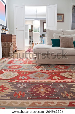Low perspective still life of interior design home living room with a white sofa with cushions, and quality carpets, home interior. Aspirational and relaxing home family room, indoors lifestyle. - stock photo
