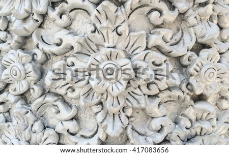 Low relief cement thai style handcraft of thai temple for background and design. Thai background. Thai texture. Thai design. Thai art. - stock photo