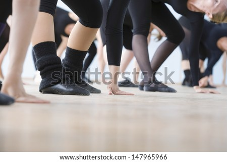 Low section of ballet dancers practicing in rehearsal room - stock photo