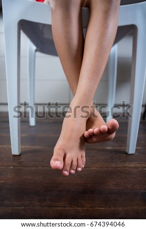 legs crossed at ankle stock images royaltyfree images