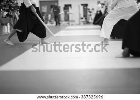 Low section of people practicing aikido - stock photo