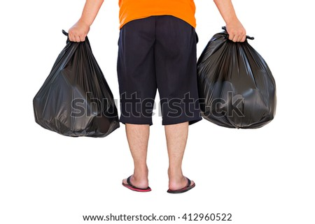 Low section of young man carrying garbage bags isolated on white background - stock photo