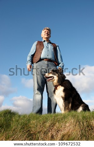 Low shot of a Mature man and his dog - stock photo