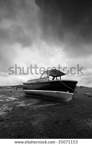 Low tide and boat in black and white
