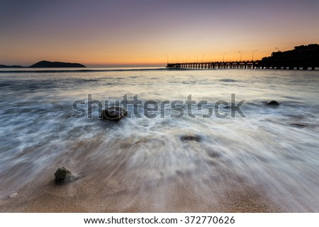 Low tide and great water reflection during sunset on Thavorn beach in Phuket Thailand - stock photo