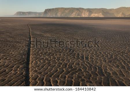 low tide at Karekare beach - stock photo