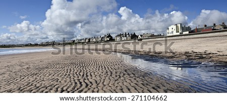 Low tide at Newbiggin-by-the-sea in Northumberland, England  - stock photo
