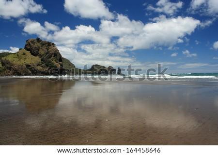low tide at Piha Beach, New Zealand - stock photo