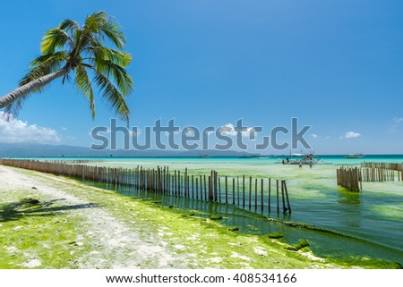 Low tide at  White Beach of  Boracay island of Philippines - stock photo