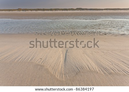 Low-tide on the beach - stock photo